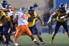 2015 le football de NCAA - état de l'Oklahoma chez la Virginie Occidentale Images libres de droits