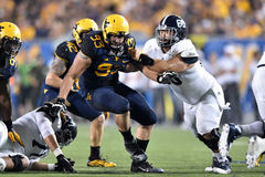 2015 le football de NCAA - GA @ WVU du sud Photographie stock
