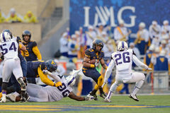 2014 le football de NCAA - TCU-WVU Photographie stock