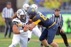 2014 le football de NCAA - TCU-WVU Photos libres de droits