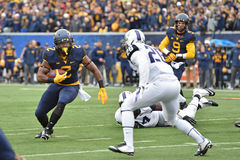 2014 le football de NCAA - TCU-WVU Photos libres de droits