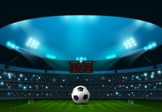 le football du football avec le tableau indicateur et le projecteur Photographie stock libre de droits