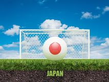 Le football du Japon sur le football ou le terrain de football Photo libre de droits