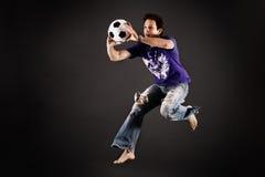 Le football jouant attrapant une bille Photographie stock libre de droits