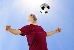 Le football jouant la boule Photos stock