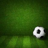Le football ou le football jouant la boule de fond Images stock