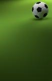 Le football sur le fond vert Photo libre de droits