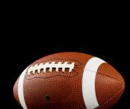 Le football sur le noir photos stock