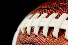 Le football sur le noir Images libres de droits