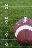 Le football sur une zone Image stock