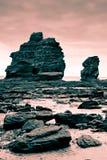 Le formazioni rocciose hanno filtrato il colore rosso Fotografia Stock