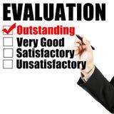 Le formulaire et la main d'évaluation vérifient exceptionnel Image stock