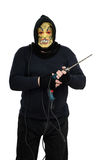 Le fou masqué menace par le grand foret Image stock