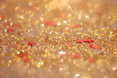 Le foyer mou et l'image sélective sur l'étoile rouge sur l'or allument le bokeh t Image stock