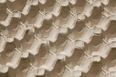 Le foyer sélectif sur le plateau de carton pour des oeufs, image abstraite aiment le fond de répétition Image libre de droits