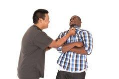 Le frère saisit son frère par le collier de chemise Images stock