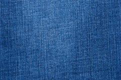 Le fragment des blues-jean naturelles d'abrégé sur plan rapproché donnent au fond une consistance rugueuse Images stock
