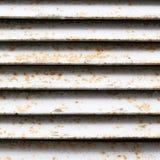 Le fragment rouillé blanc d'axe de ventilation photographie stock libre de droits