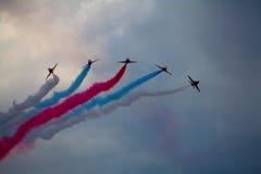 Le frecce rosse, conosciute ufficialmente come il gruppo acrobatici di Royal Air Force Fotografia Stock Libera da Diritti