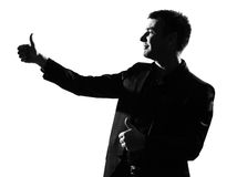 Le gagnant d'homme de silhouette manie maladroitement vers le haut Photos stock