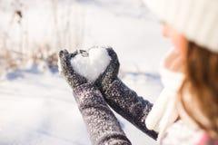 Le gant de Madame et le coeur de neige Image libre de droits