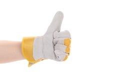 Le gant de travailleur de la construction manie maladroitement. Photo stock