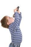 Le garçon avec un microphone chante Image stock