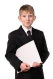 Le garçon dans un procès d'affaires Photographie stock