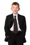 Le garçon dans un procès d'affaires Image libre de droits