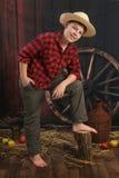 Le garçon de l'agriculteur heureux Photographie stock