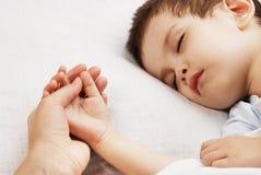 Le garçon de sommeil Photographie stock