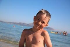 Le garçon de sourire Images libres de droits