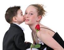 Le garçon embrassent d'abord Photographie stock libre de droits
