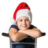 Le garçon en sourire de chapeau de Santa Claus Photos stock