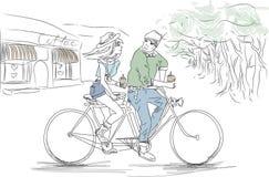 Le garçon et la fille sur un vélo tandem Images stock