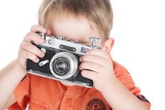 Le garçon et un appareil-photo Photographie stock libre de droits