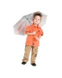 Le garçon et un parapluie Images stock