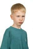 Le garçon fâché. Photographie stock