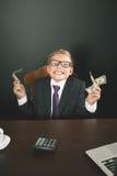 Le garçon a gagné beaucoup d'argent Image libre de droits
