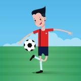 Le garçon jouant au football Photographie stock libre de droits