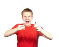 Le garçon l'adolescent va avoir un rasage la première fois Photographie stock