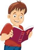 Le garçon a lu la bible Photo stock