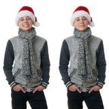 Le garçon mignon d'adolescent dans le chandail gris au-dessus du blanc a isolé le fond Photo stock