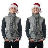 Le garçon mignon d'adolescent dans le chandail gris au-dessus du blanc a isolé le fond Image stock
