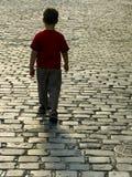 Le garçon part Images libres de droits