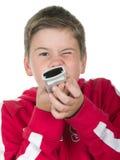 Le garçon retient un panneau de commande Photos libres de droits