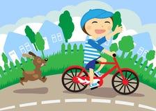 Le garçon sur la bicyclette Image libre de droits