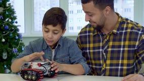 Le garçon tient ATV dépisté par jouet dans des ses mains banque de vidéos
