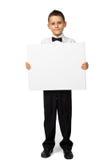 Le garçon tient une bannière Photographie stock