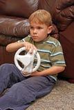Le garçon joue le jeu vidéo Image libre de droits